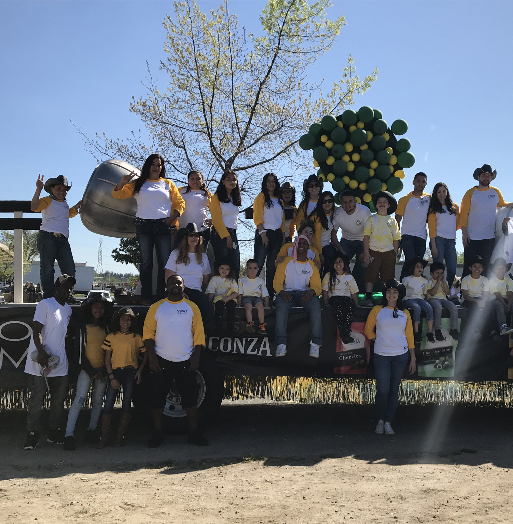Sconza Chocolate employees on the Oakdale Rodeo float